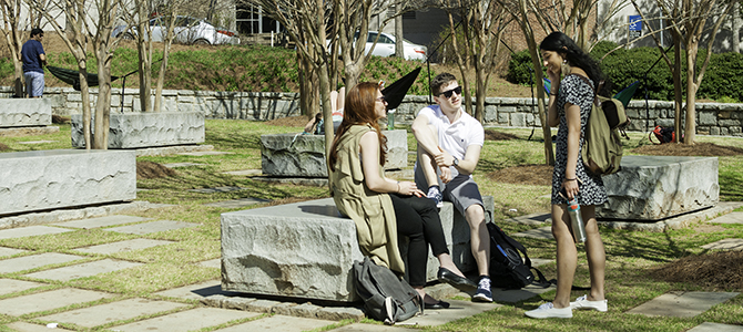 students sitting and talking in memorial garden
